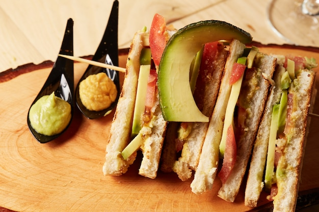 Club sandwich on wood tray