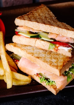 Club sandwiches with toast, ham and vegetables.