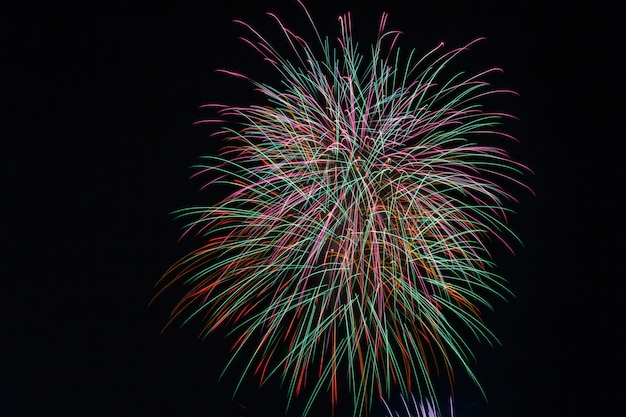 Cluster of colorful fourth of april fireworks.