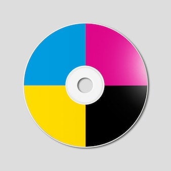 Cmyk cd - dvd on grey surface
