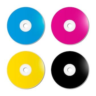 Cmyk cd - dvd set on white surface