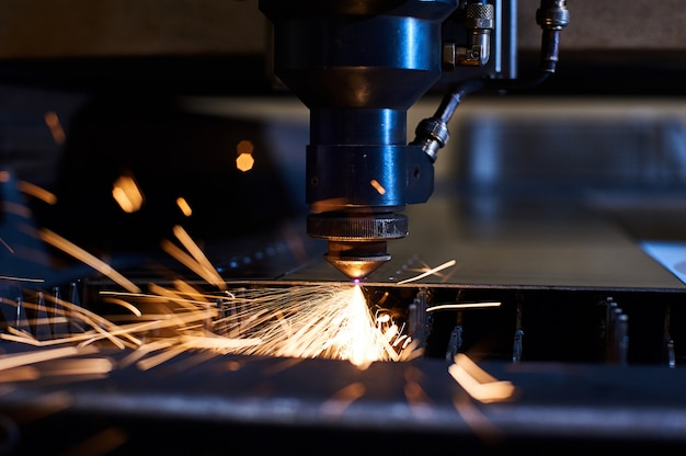 Cnc laser cutting of metal close up, modern industrial technology. small depth of field