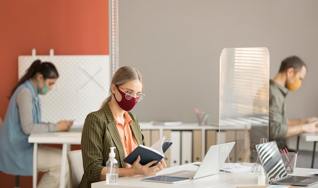 Co workers wearing face mask at work