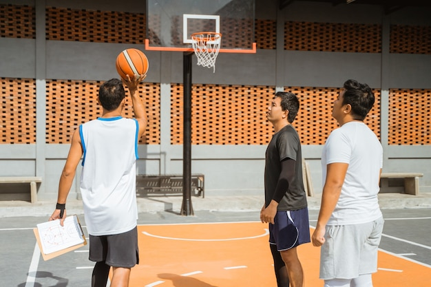 A coach gives the example of shooting the ball into the hoop