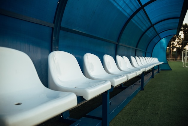 Coach and reserve benches in a soccer field.soccer bench seats