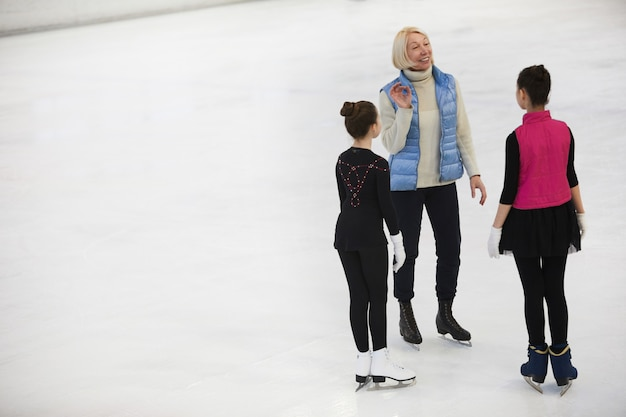 Coach training figure skaters