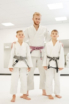 Coach and young judoists