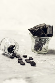 Coal and activated carbon tablets on the table