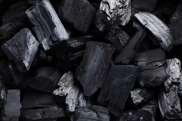 Coal mineral black as a cube stone.