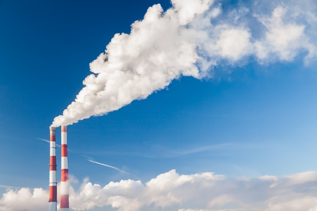 Coal processing plant. smoke of pipes pollutes atmosphere of city.