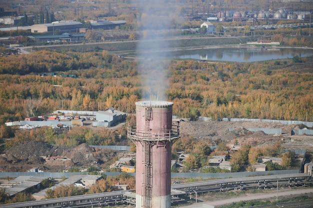 Coal processing plant. smoke of pipes pollutes atmosphere of the city.