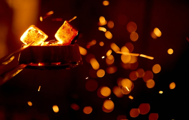 On the coals for the hookah blowing hookah flying sparks with a beautiful side . high quality photo