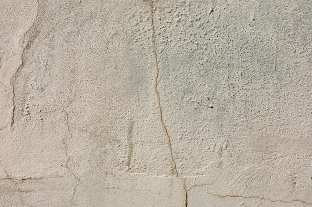 Coarse concrete surface with cracks