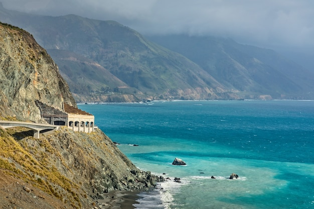 The coast of big sur with a tunnel on pacific coast highway 1, california