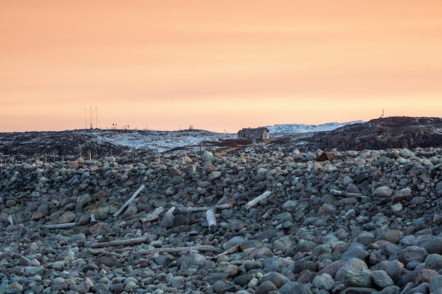 The coast of the kola peninsula, garbage thrown up by the tide.