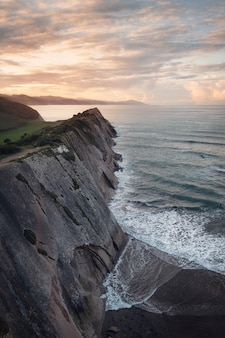 Coast landscape of famous flysch in zumaia at sunset, basque country, spain. famous geological formations.