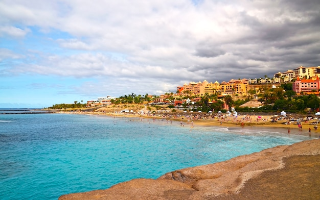 Coastal view of el duque beach in costa adeje, tenerife, canary islands, spain