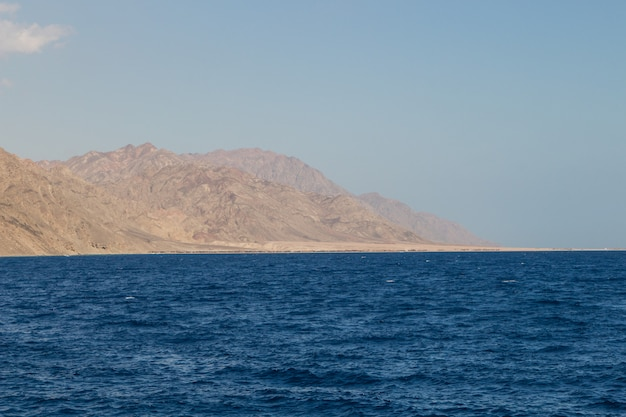 The coastline of the red sea and the mountains in the background. egypt, the sinai peninsula. Premium Photo