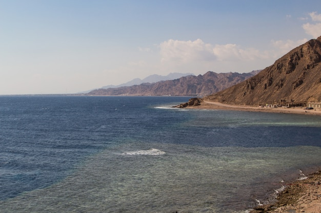 The coastline of the red sea and the mountains . egypt, the sinai peninsula. coral reef blue hole.