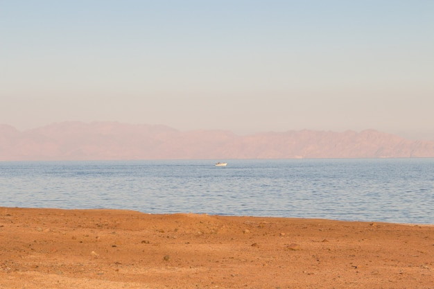 The coastline of the red sea and the mountains , sunset. egypt, the sinai peninsula.