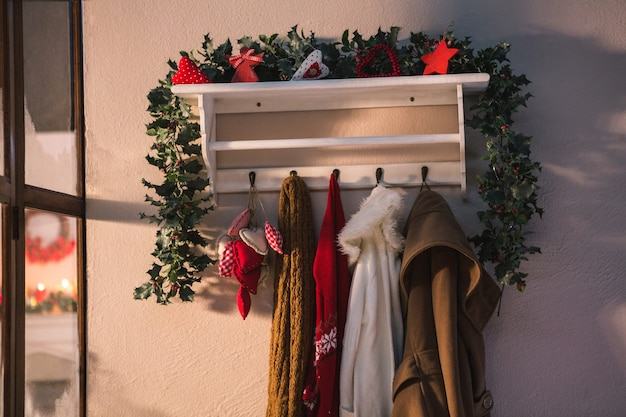 Coat rack decorated with christmas motifs and jackets