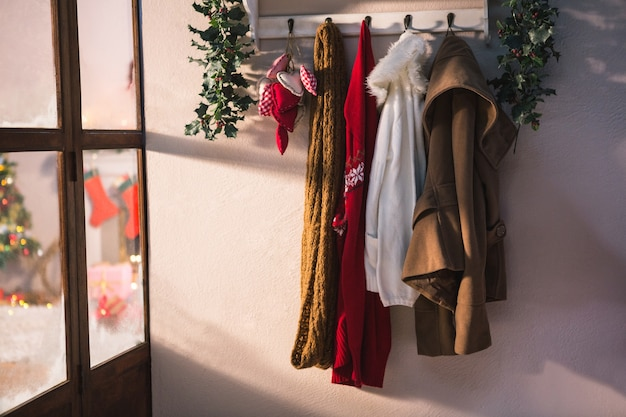 Coat rack with hanging winter clothes