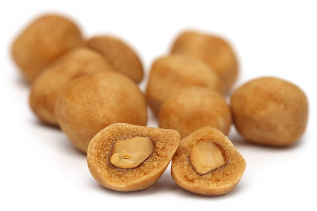 Coated peanuts over white background
