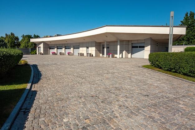 Cobblestone driveway leading to multi-car garage on private estate