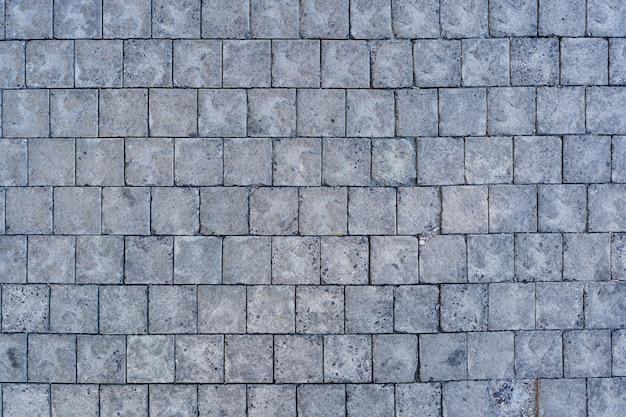 歩道のテクスチャにエッジコースがある石畳の舗装道路