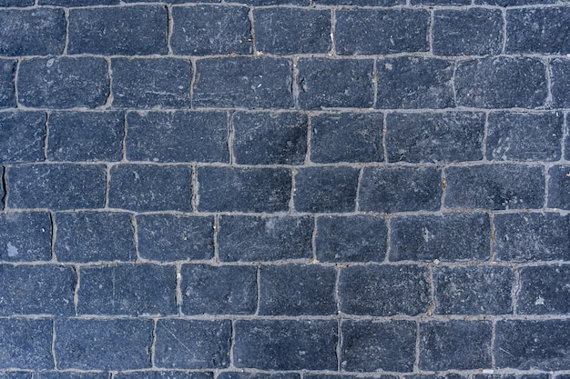 Cobblestone pavement road with edge courses at the sidewalk texture