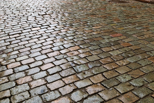 Cobblestones. large square boulders stones on road. road surface.