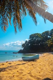 Cocalito beach in punta de sal and a local boat, tela. honduras