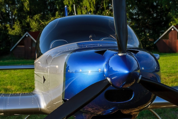 Cockpit and propeller of a small 2-seater aircraft close up.