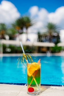 Cocktail against the blue of the pool