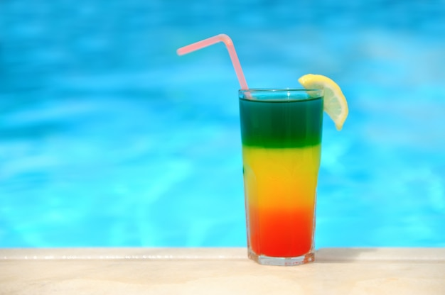 Cocktail on the background of the pool