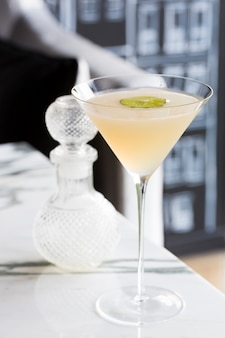 Cocktail decorated with lime serve on marble table Premium Photo