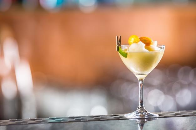 Cocktail drink frozen margarita at barcounter in night club or restaurant.