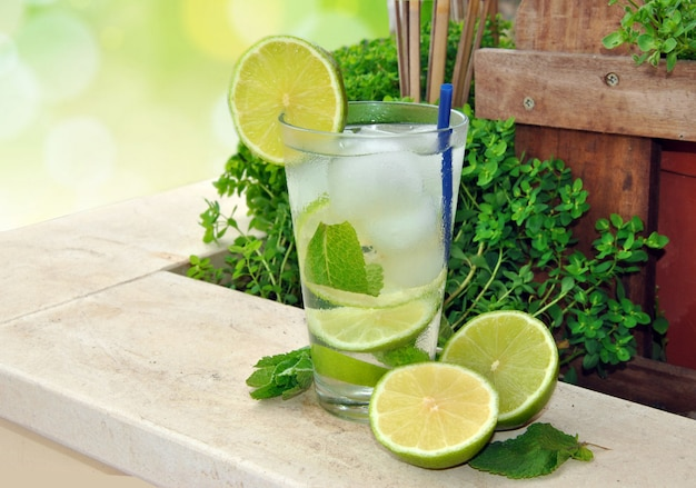 Cocktail mojito made with run, mint and lime in summer terrace
