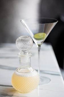 Cocktail serve in beautiful bottle on marble table