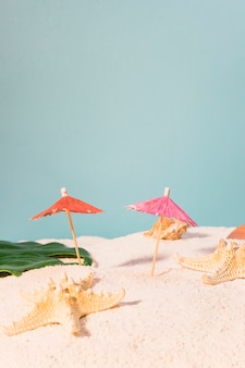 Cocktail umbrellas and starfish on beach