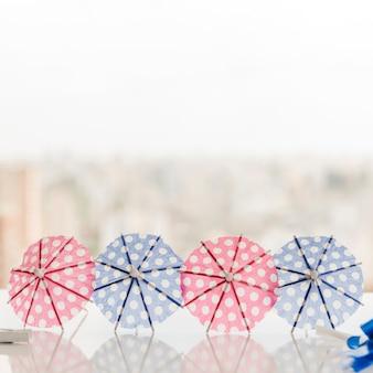 Cocktail umbrellas on table
