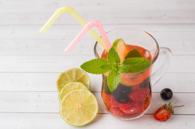Cocktail with black currant, strawberry, mint and lime. cooling summer drink.