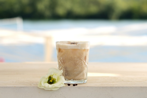 Cocktail with coffee beans in a glass beaker