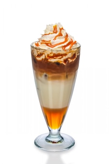 Cocktail with coffee, caramel syrup and whipped cream isolated on white