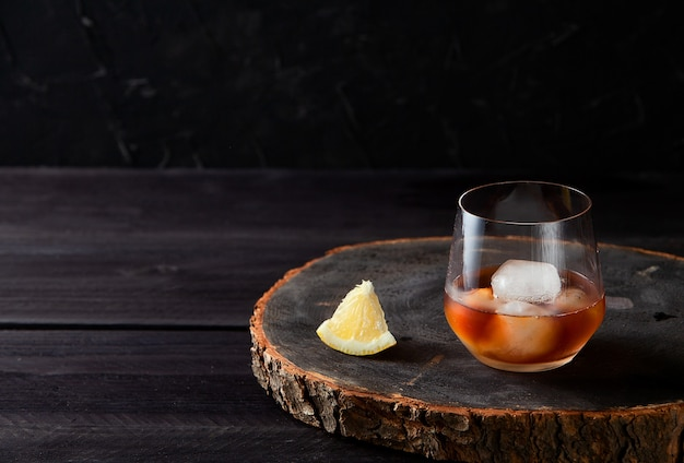Cocktail with on dark wooden table