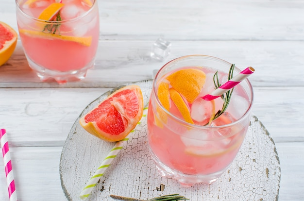 Cocktail with grapefruit slice on a wooden table