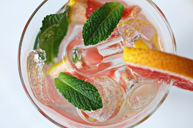 Cocktail with ice, mint, grapefruit and vodka.