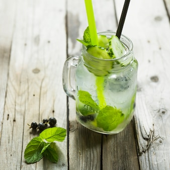 Cocktail with mint and lime in mason jar