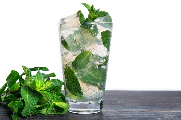 Cocktail with mint and crushed ice isolated on a white
