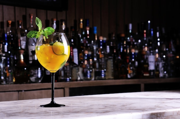 Cocktail with orange and lemon
